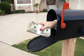 Mailbox and buncle of cash — Stock Photo