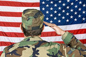 Saluting the American Flag — Stock Photo