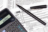 Tax forms, calculator and pen — Stock Photo