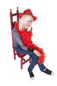 Teenager wearing feather boa and hat — Stock Photo