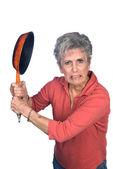 Angry mother swinging a frying pan — Stock Photo