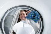 Man doing laundry — Stock Photo