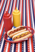 Fourth of July hotgogs with ketchup and mustard — Стоковое фото