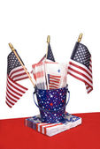 July Fourth napkins and American flags — Stock Photo