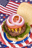 Juicy fourth of July hamburger — Stock Photo