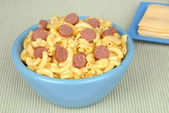 Macaroni and cheese with sliced hotdogs — Stock Photo