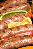Barbecued bratwurst — Stock Photo