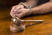 Arrested man and gavel — Stock Photo