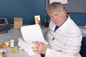 Doctor and bureaucracy — Stock Photo