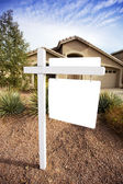 Blank home for sale sign — Stock Photo