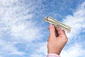 Man tossing paper money plane — Stock Photo