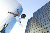 Man jumping off building — Stock Photo