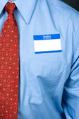 Businessman wearing blank nametag — Stock Photo