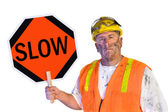 Construction worker holding a slow sign — Stock Photo