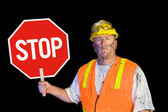 Construction worker holding stop sign — Stockfoto