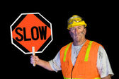 Dirty construction worker holding slow sign — Stockfoto