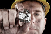 Silver miner with nugget — Stock Photo
