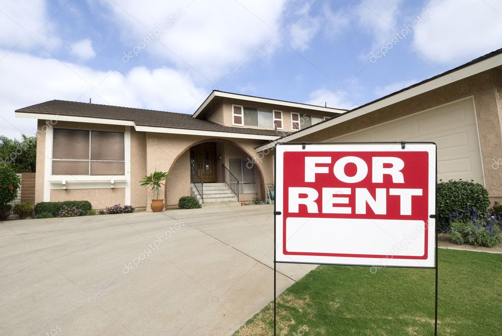 A home is being rented during tough economic times. Focus is on the sign.  Stock Photo #7637062