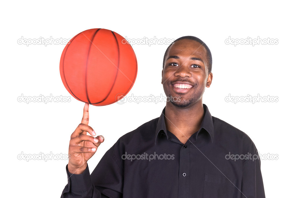 An African American man spins a basketball on his finger. — Stock Photo #7637406