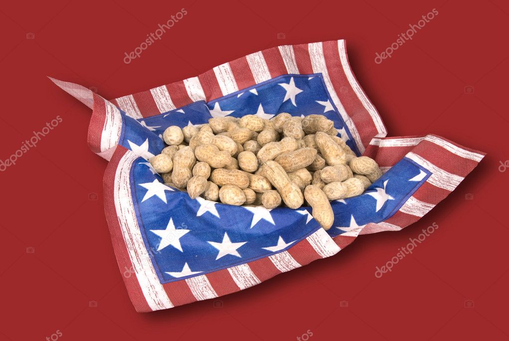 A basket of peanuts with a July fourth theme on a red background. — Stock Photo #7637573