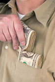 Putting cash in pocket — Stock Photo