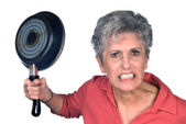 Angry mother and frying pan — Stock Photo