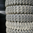 Old spiked tires - Stock Photo