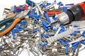 Screwdriver, pleiers, screw, dowels and electric connectors — Stock Photo