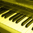 Colored sepia photo of electronic piano — Stock Photo