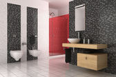Modern bathroom with black, red and white tiles — Stockfoto