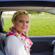 Happy businesswoman in a car — Stock Photo #7109398