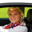 Happy businesswoman in a car — Stock Photo