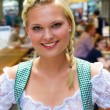 Young girl in a dirndl - Stock Photo