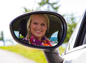 Happy businesswoman in a car — Stok fotoğraf