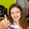 Little girl with thumb´s up - Stock Photo