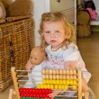 Stock Photo: Cute baby with abacus