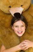 Happy girl with teddy bear — Stock Photo