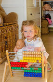 Cute baby with abacus — Stock Photo