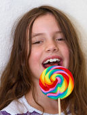 Little girl with colorful lollipop — Stock Photo