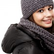 Girl wearing a hooded winter coat - Foto Stock