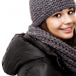 Girl wearing a hooded winter coat - Stok fotoğraf