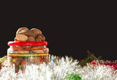 Nuts heaped in a Christmas-themed plastic container — Stock Photo