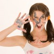 Young woman with paint on his face — Stock Photo