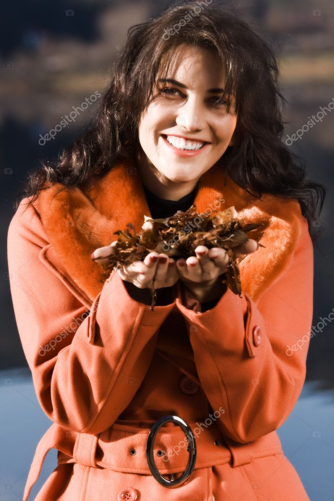 Young woman blowing leaves from your hand — Stock Photo #7669245