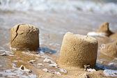 Sand pies at a sea coast — Stock Photo