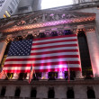 Iconic building of NYSE at dusk - Stock Photo