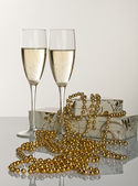 Christmas decoration glasses of champagne with packed gifts and — Stock Photo