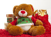 Christmas bear sitting with presents — Stock Photo