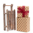Old wooden sledge with gift an white — Stock Photo