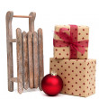 Old wooden sledge with christmas presents on white — Stock Photo